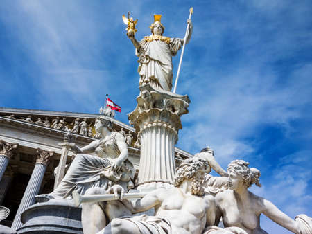 pallas: parliament in vienna, austria. with the statue of pallas athena of the greek goddess of wisdom.
