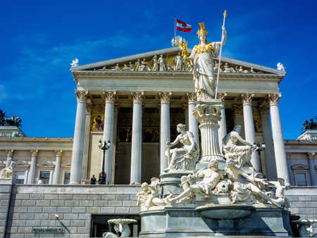 parliament in vienna, austria. with the statue of pallas athena of the greek goddess of wisdom. photo