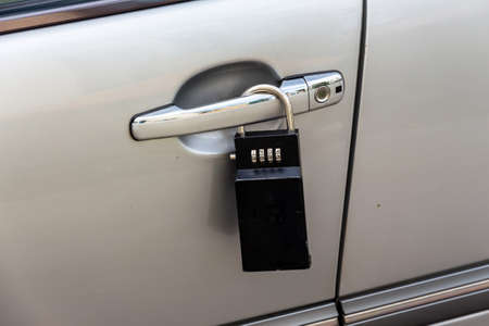insider information: car door with padlock icon for theft protection, security, protection Stock Photo