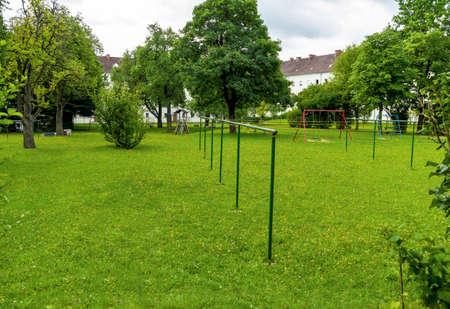 residential neighborhood: backyard with playground, a symbol for residential, neighborhood recreation