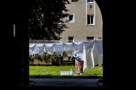 duties: hang laundry in the backyard, a symbol of life, duties, cleanliness