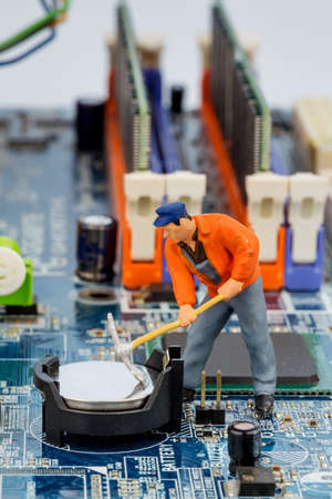 miniaturization: computer board and workers, symbolic photo for computer failure, maintenance, data security Stock Photo