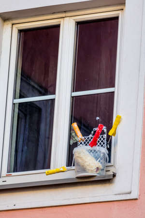 botch: art supplies in front of a window, symbol of the renovation, repair, botch