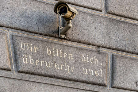 domestic policy: surveillance camera on a building, symbol of monitoring, home security, control, data protection