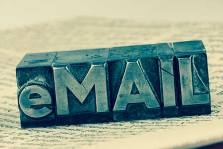 inform: the word e-mail letters written in lead. photo icon for quick correspondence