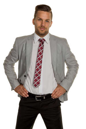 self assured: a man  stands in front of a white background