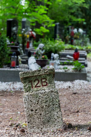 transience: numbered grave location, death, forget anonymity and transience Stock Photo