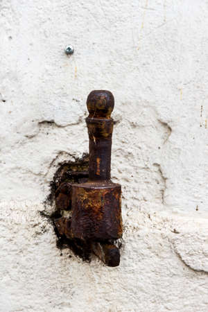 transient: rusty hinge of iron, symbol of decay, impermanence, old iron