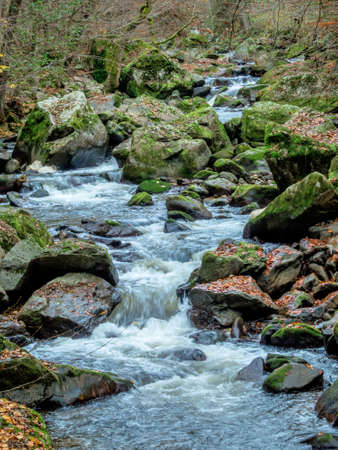 virtue: a creek with rocks and flowing water. landscape experience in nature. Stock Photo