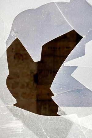 glass break: a broken window on a patio door