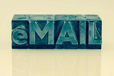 the word e-mail letters written in lead. photo icon for quick correspondence