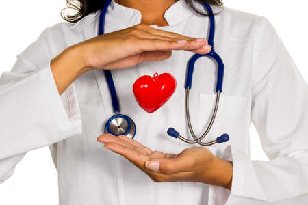 physican: a young doctor  symbolically holding a heart in his hand. Stock Photo