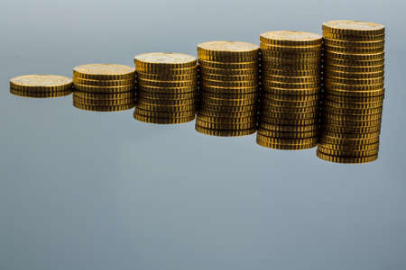 yield: stacked coins ascending series, symbolic photo for financial planning, increasing yield and good rate of return