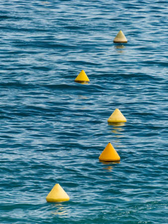 limitation: yellow buoys float as a limitation in the sea