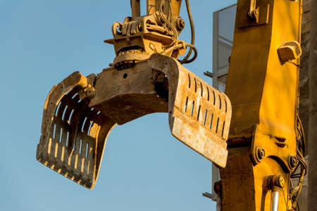 contruction: excavator on a construction site during the demolition of a hauses.platz for new housing and living space is required