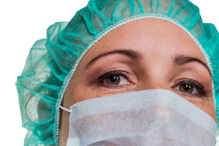 doctor stress: a nurse or doctor in surgical clothing before surgery. symbolic photo for stress and overtime in the hospital.