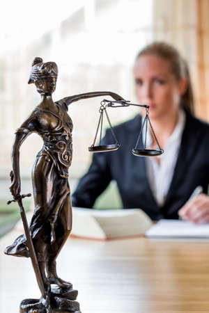 law office: businesswoman sitting in an office. photo icon for managers, independence or lawyer. Stock Photo