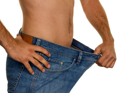 thinness: a man has taken off with a successful diet a lot of body weight.