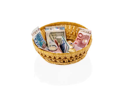 tipping: a basket with money for donations and gratuities Stock Photo
