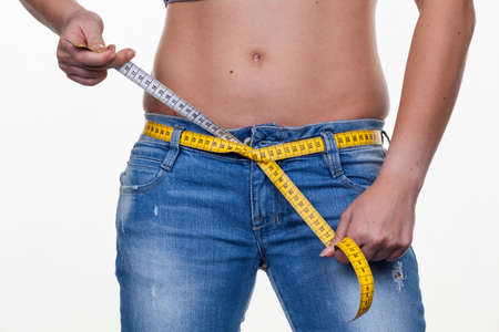 where to eat: a young woman with a tape measure before the next diet. losing weight and fast