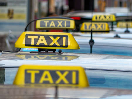 pkw: taxis wait at a taxi rank, symbolic photo for passenger transport and service