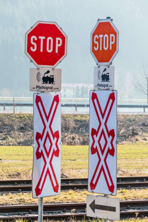 bureaucratic: stop signs railway crossing whistle, symbol of rail transport, risk, safety Stock Photo