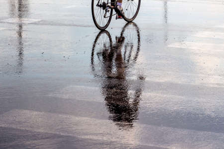 cyclists in the rain, a symbol of bad weather, accident risk, mobility, fitness