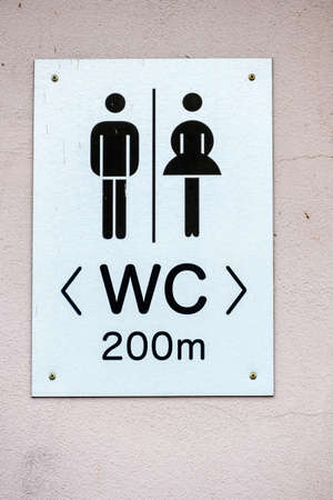 latrine: sign restrooms man woman icon for plumbing, gender segregation, hygiene, Stock Photo