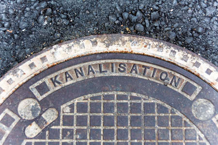 derivation: cover for sewers, symbolic photo for sanitation and water management