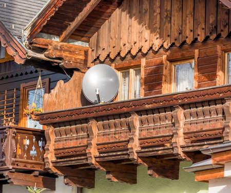 compulsory: traditional house with satellite dish, symbol of communication, radio, television, internet