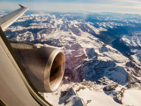 flight: seen the alps in austria from an airplane in a flight from