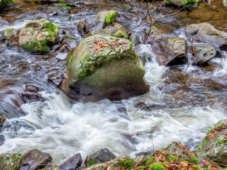 relaxen: a creek with rocks and flowing water. landscape experience in nature. Stock Photo