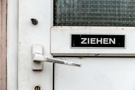 gastroenteritis: latch on an old toilet door, symbol of plumbing equipment, dirt, unkempt