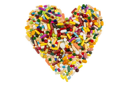 therapie: colorful tablets arranged in heart shape symbol photo for heart disease, medication and pharmaceuticals