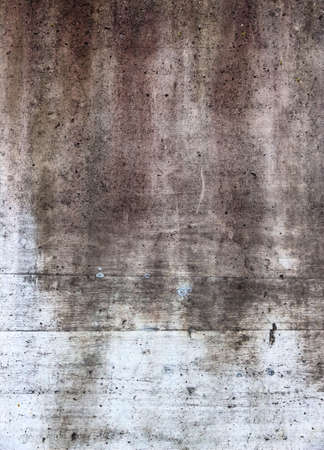 wetness: gray wall with discoloration, symbol of decay, change,
