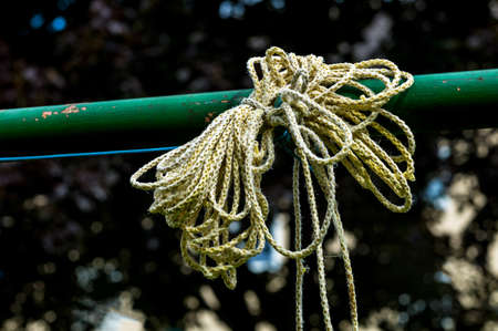 knotting: clothesline in a garden safety and reliability Stock Photo