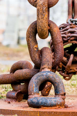 transience: a rusted iron chain, symbol of decay, aging, transience, old iron