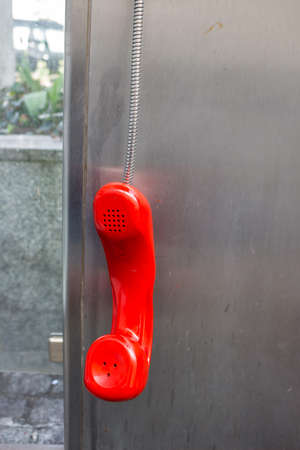 cell phone booth: a phone booth telekom austria with a red telephone receiver