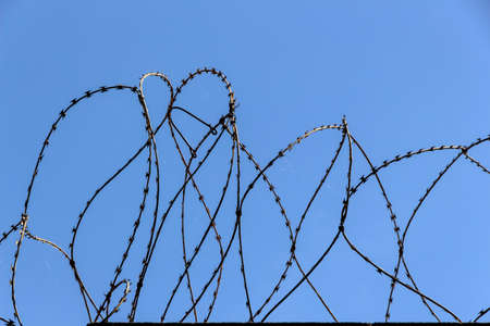 demarcation: a site is protected with barbed wire