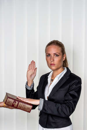 credible: a woman says as a witness in court in a lawsuit. is sworn in and swears on the bible.
