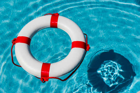 crisis management: an emergency tire floating in a pool. symbolic photo for rescue and crisis management in the financial crisis and banking crisis.