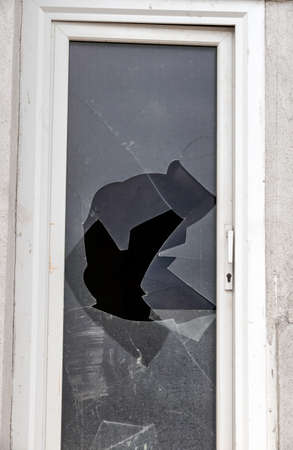 a broken window on a patio door