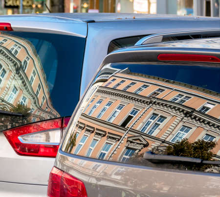 rehabilitated: beautiful old houses are reflected in the windows of a car