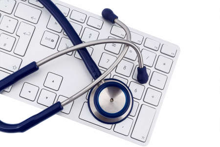 edv: stethoscope and keyboard of a computer, symbolic photo for diagnosis and appointment management Stock Photo