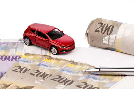 behave: the purchase contract for a new car at a swiss car dealers. with swiss francs.