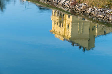 living idyll: building reflected in the water, a symbol of peace, idyllic, meditation