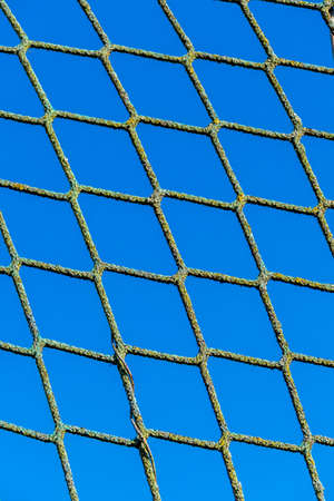 incarcerated: power and blue sky as a symbol of network, captivity, border security Stock Photo