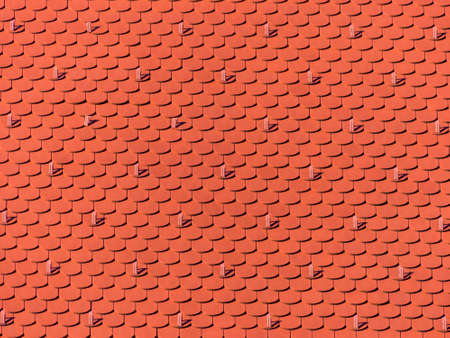 the roof of an old building  was newly renovated. new roof tiles on house Stock Photo