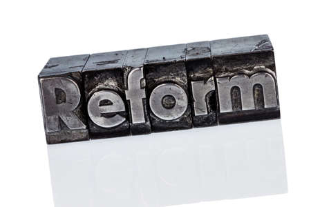 indebtedness: the word  reform in lead letters written. photo icon for quick correspondence