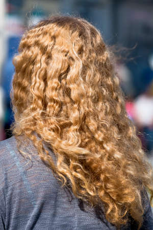 occiput: woman with long blond hair, a symbol of femininity, anonymity